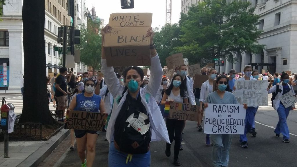 Doctors march for racial justice in D.C.: 'White coats, black lives'