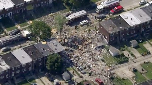 Explosion levels Baltimore homes; 1 dead, 1 trapped